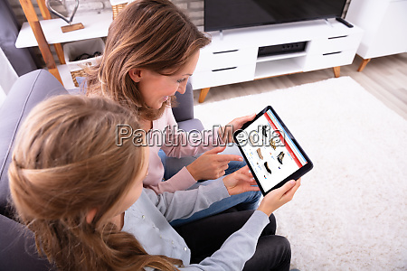 mother and daughter shopping online on