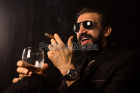 laughing successful businessman with cigar