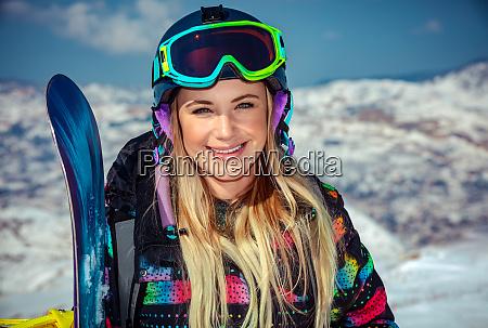 beautiful woman with snowboard