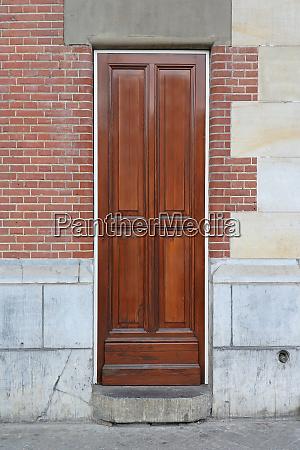 narrow door brickwall facade