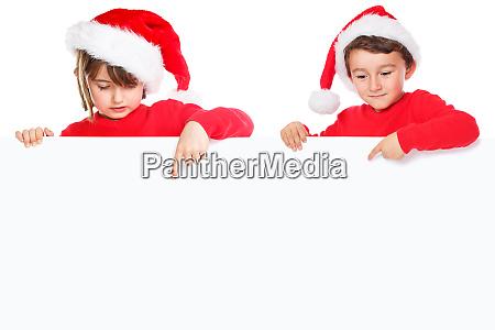 christmas children kids santa claus pointing