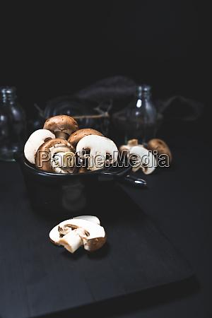 champignon mushroom on the dark table