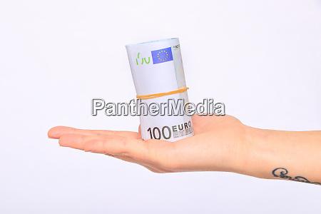 euro money roll in hand