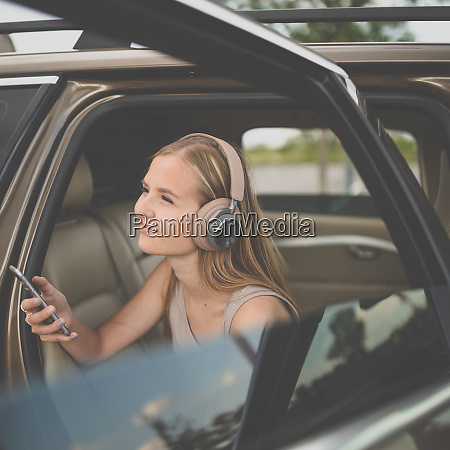 cute teenage girl listening to her