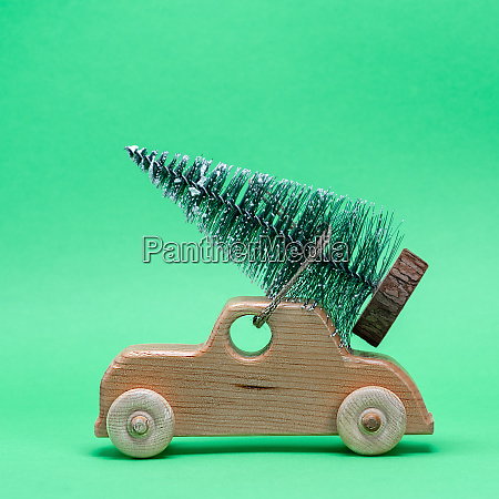wooden toy car carrying a festive