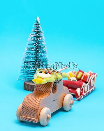 wooden childrens car carries a caramel