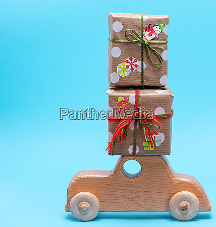 wooden childrens machine carries gifts wrapped