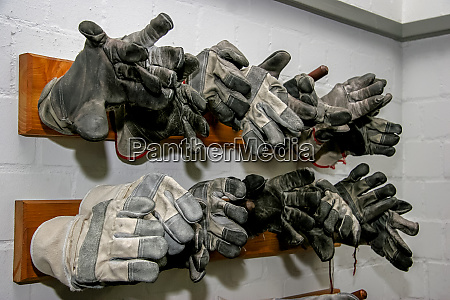 working gloves at the wall