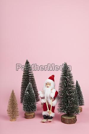 santa claus skiing on a pink