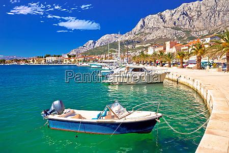 colorful makarska boats and waterfront under