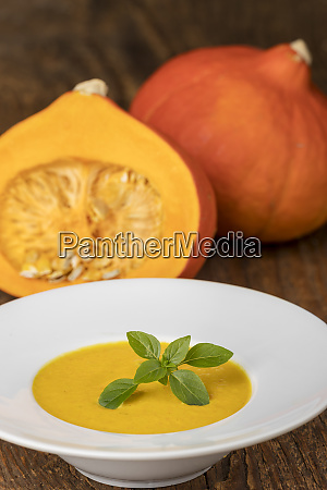 closeup of pumpkin soup on wood