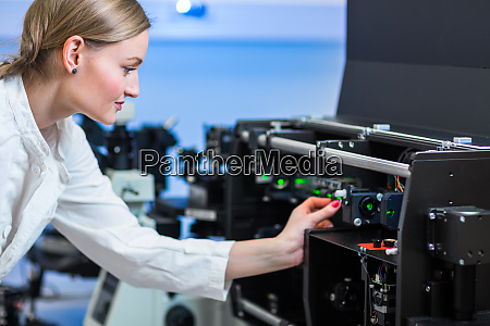 female researcher carrying out research in