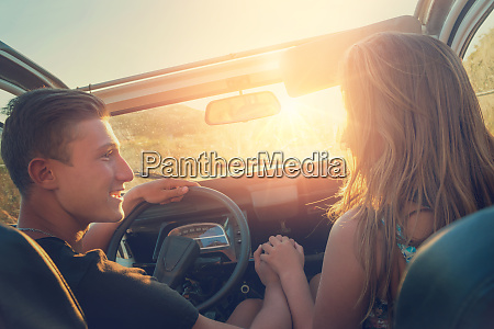 couple, in, a, car, at, sunset - 26136343