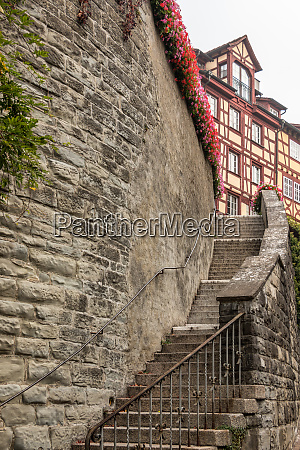 high stone wall with a long