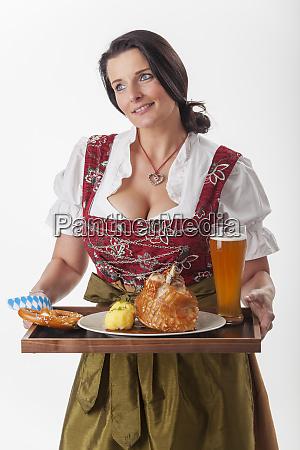 bavarian woman in a dirndl serving