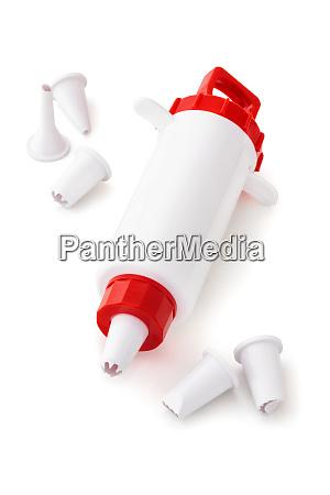 confectionery syringe on white