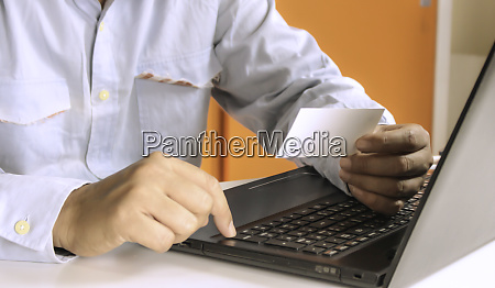 hands using laptop and check business