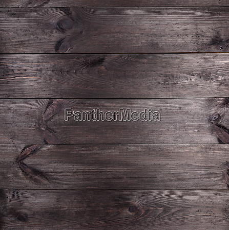 background of parallel brown wooden pine