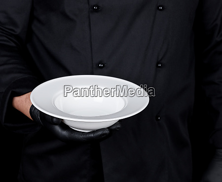 cook in black uniform and black
