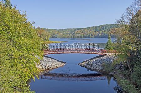 graceful footbridge by a north woods