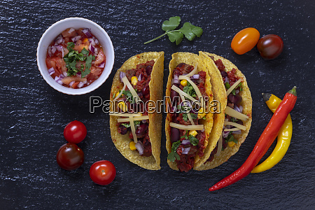 overview of three tacos on slate