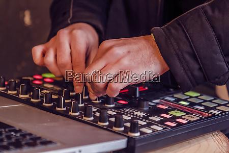 sound engineer hands working on sound