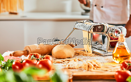 chef making homemade pasta in a
