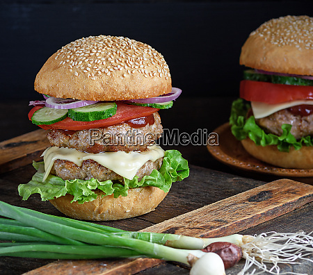 burger with two fried cutlets cheese