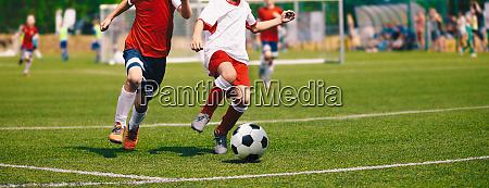 junior soccer match football game for