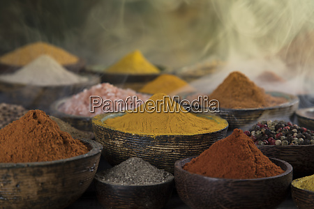 smoke aromatic spices on wooden background