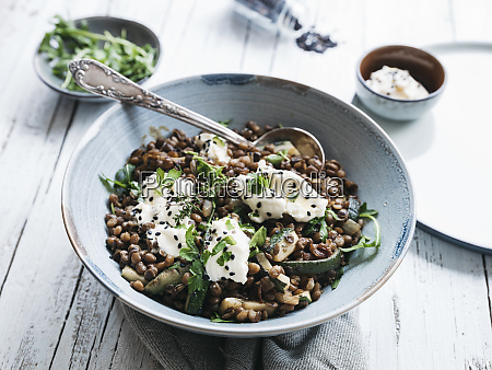 delicious lentils bowl with zucchini rucola
