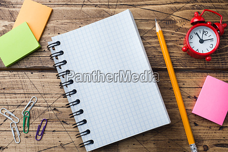 pencil and notepad with spiral on