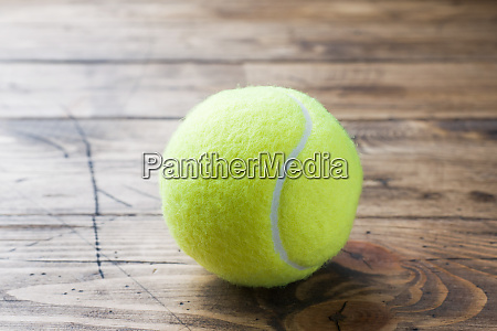 tennis ball on wood background sport