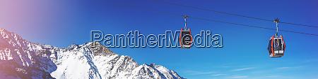 ski cable cars over mountain landscape