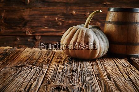 big pumpkin and oak barrel in