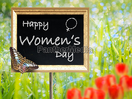 black chalkboard with text happy womens