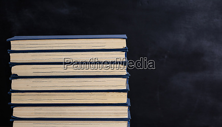 books with blue cover black background