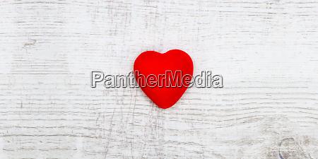 red heart wooden background valentine day