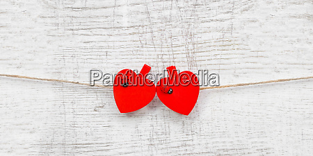 red hanging hearts with ladybug