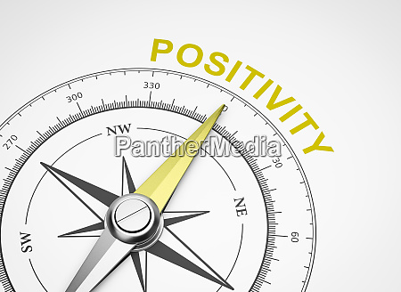 compass on white background positivity concept