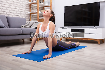 beautiful young woman doing workout at