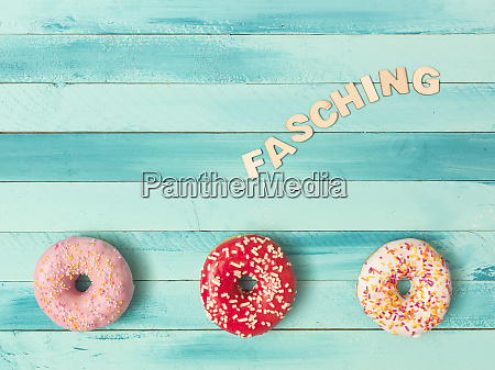 turquoise carnival background with donuts and