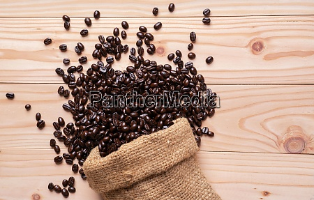 coffee beans spilled out from linen
