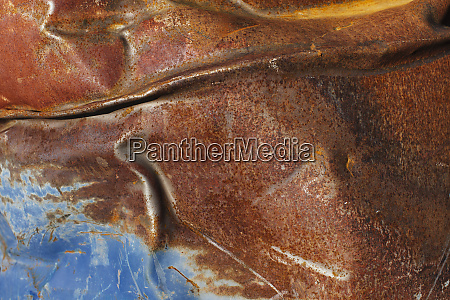 close up of dented and rusty