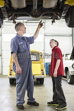 a caucasian senior male car mechanic