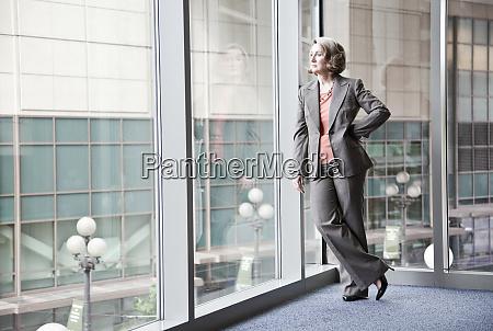 a caucasian businesswoman standing next to