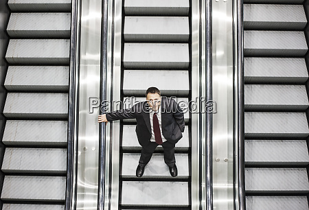 looking down on a caucasian businessman