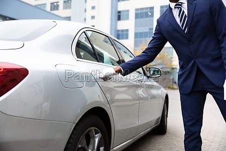 valets hand opening car door