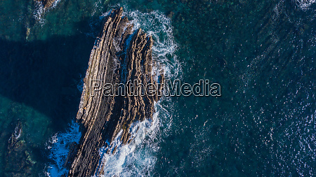 aerial view of cliffs and waves