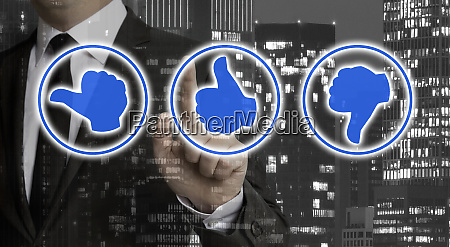 rating thumbs are shown by businessman